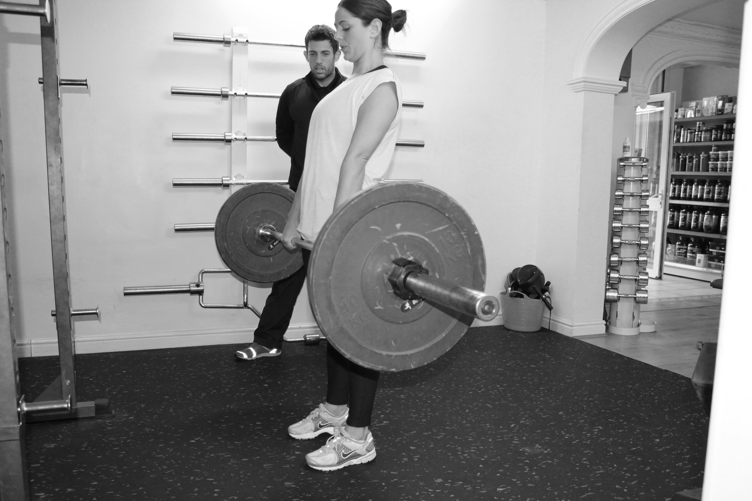 picture of personal trainer with client deadlifts